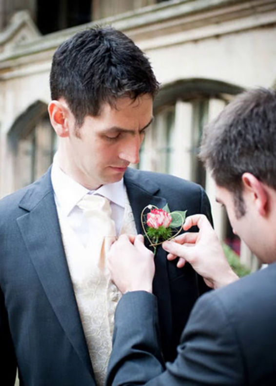 Groom receiving boutonniere