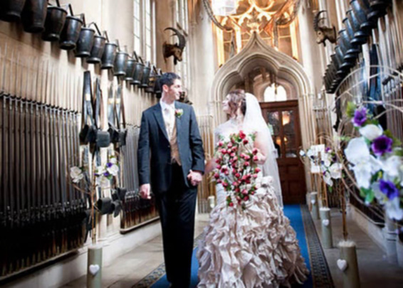 Bride and Groom Walking the entrance of Belvoir Castle