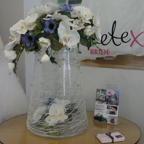 Contract vase arrangement with blue anemones and orchids and beads
