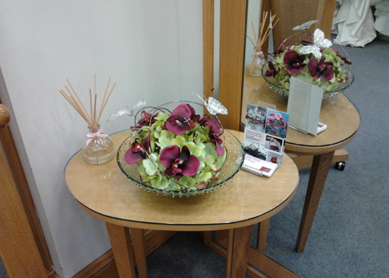 Contract arrangement with orchids and hydrangea in a bowl
