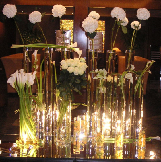 Contract vases with tall white flowers in architectural arrangements