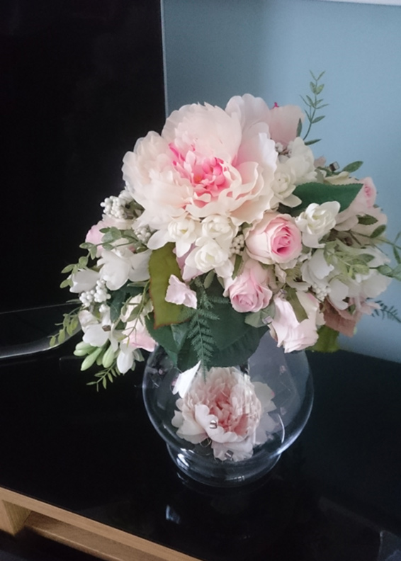 Large peony silk flower arrangement in and on a hourglass vase,reception desk contract
