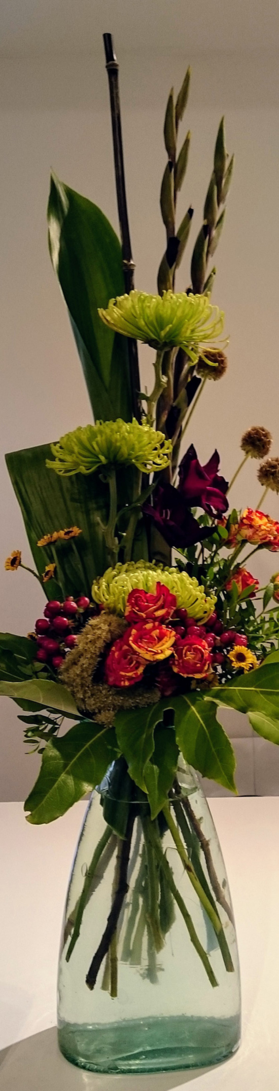 Tropical contract line bouquet, black bamboo, bloom chrysanthemums, roses, hypericum