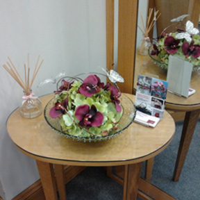 Recycled glass spotted bowl, with maroon Orchids and lime green hydrangea and butterflies