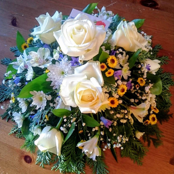 Blue, White and yellow funeral posy