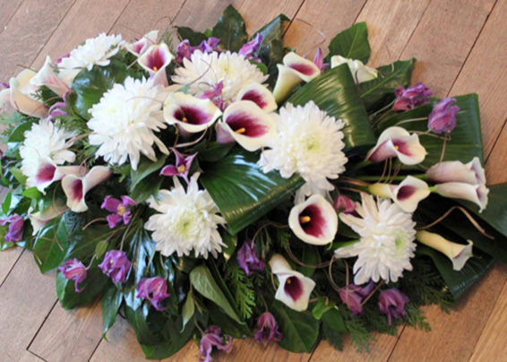 Contemporary coffin spray, White bloom chrysanthemums, purple calla lilies, funeral Tribute
