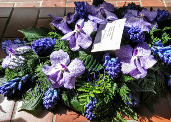 Purple vanda orchids and hyacinths coffin spray