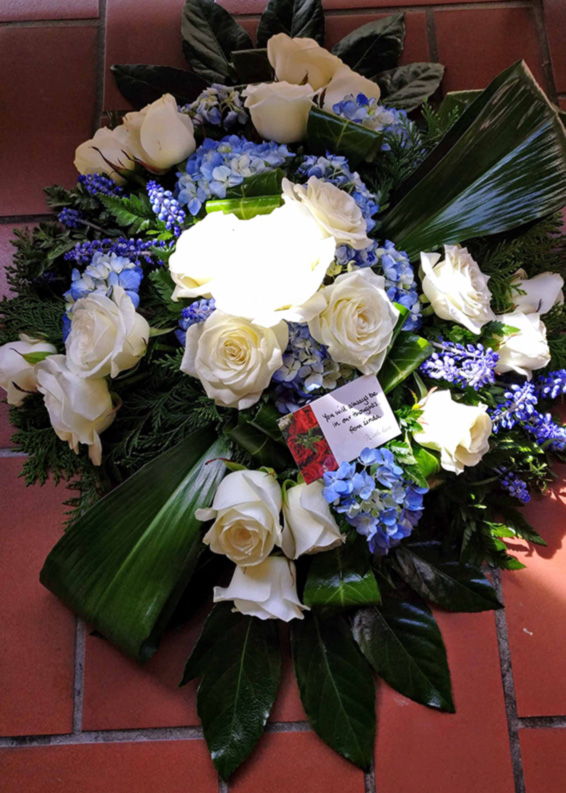Blue an White Contemporary funeral spray