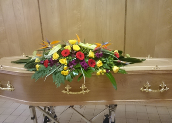 Funeral spray on a casket, exotic flowers, stralitzia, anthuriums, dendrobium orchids