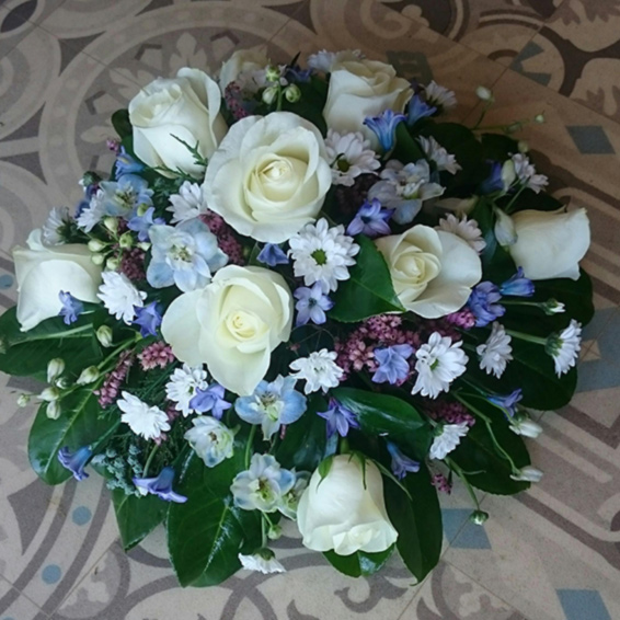 Blue, White and lilac funeral posy