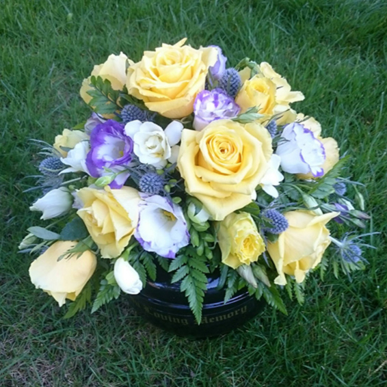 Cremation urn,yellow, white and purple roses, lisianthus