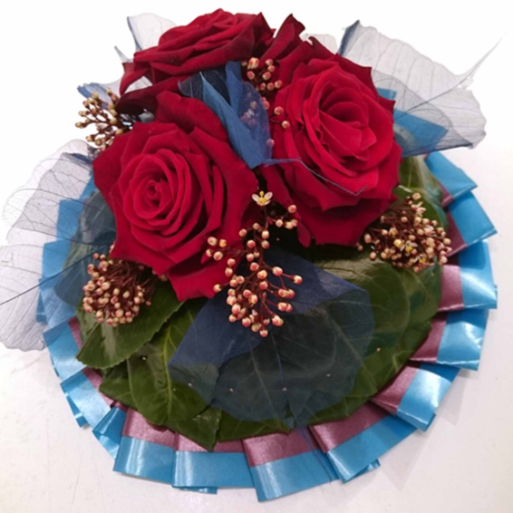 funeral posy,Rugby player colours,Red roses with blue ribbon funeral tribute