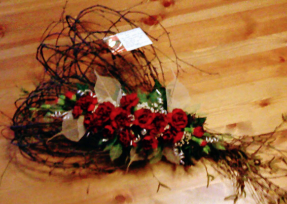 Red carnations heart tribute, with birch branches shaped as a heart