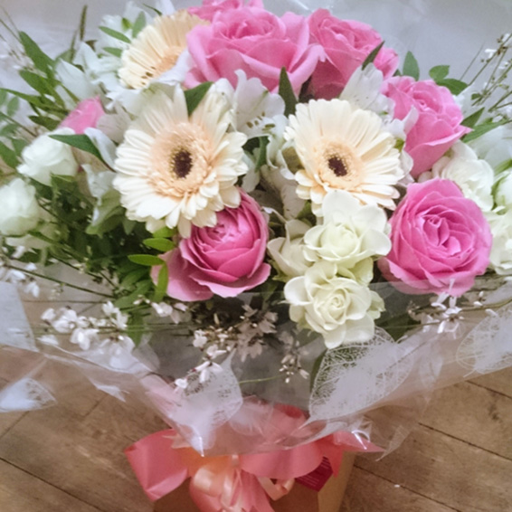 Pink and white rose, gerbera,genista, handtied bouquet