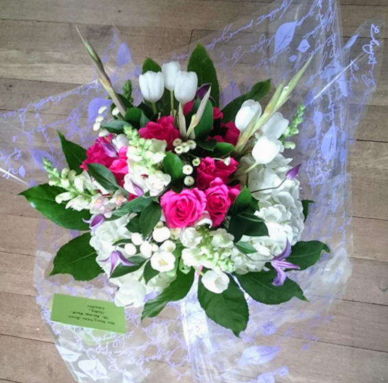 Handtied bouquet with white tulips, hydrangea, gladioli, pink roses