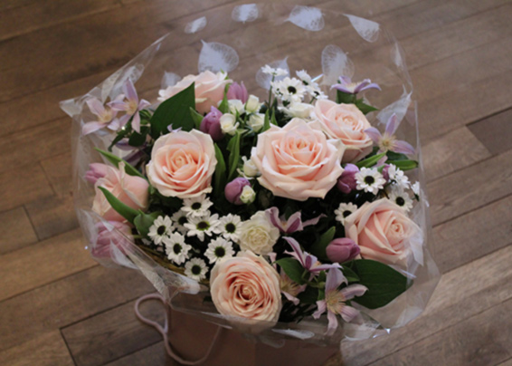 Pink avalanche roses, white spray chrysanthemums, lilac clematis