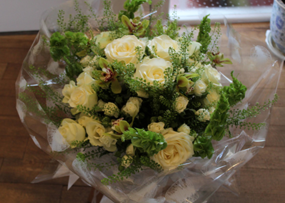 White roses, spray roses, lime green orchids and thlaspi large bouquet