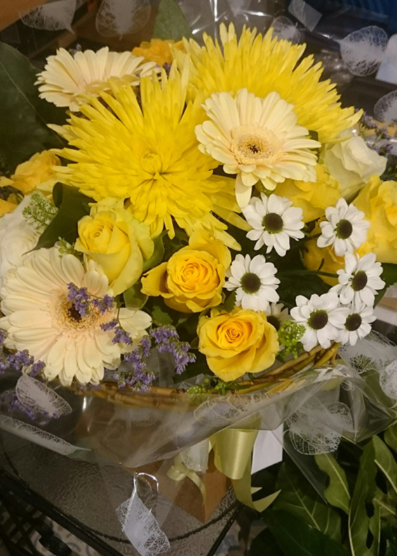 Yellow roses, bloom chrysanthemums, white spray chrysanthemums, handtied bouquet