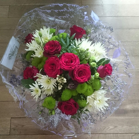 Red roses, green kermit, white spider chrysanthemums, handtied seasonal bouquet