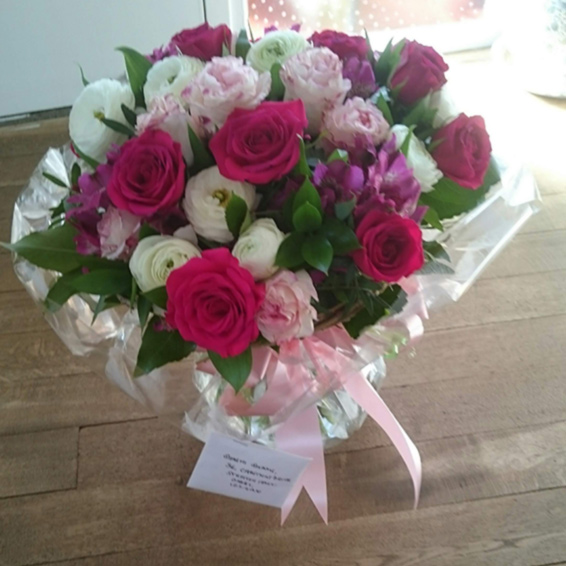 Hot pink roses, white ranunculus,alstrosemeria, pink roses, handtied bouquet