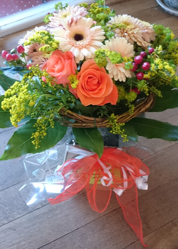 Seaonsal bouquet with orange bow