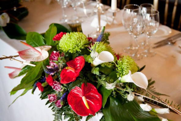 Top table arrangement with exotic flowers, Belvoir Castle