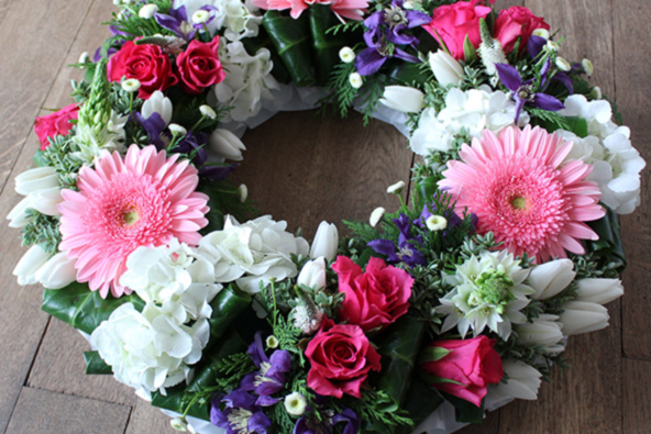 Pink, blue and white sympathy wreath