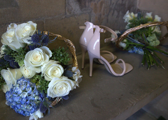 bridesmaids bouquets, blue and white with high heels