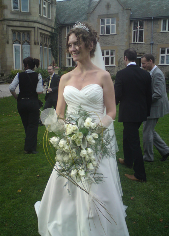 Kenwood Hall bride with her contemporary shower bouquet, roses and skeletal leaves