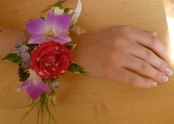 Bridesmaid wrist corsage, french manicure