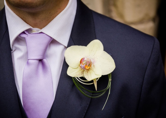Ian & Eleanor grooms contemporary orchid buttonhole with wire and bear grass