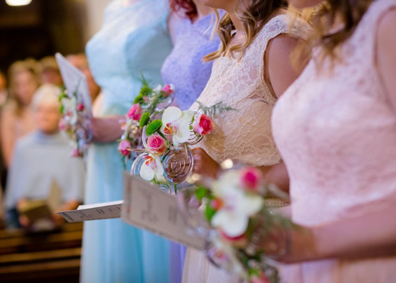 Contemporary bridesmaids posies in church