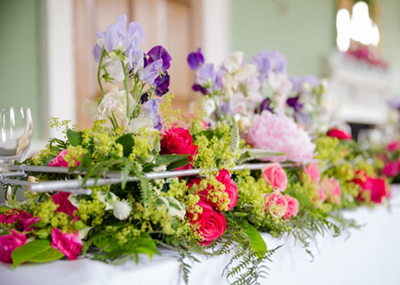 Top table, contemporary peonies, sweatpeas and roses flower arrangement