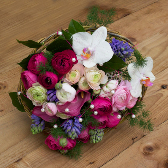 Bridesmaids bouquet, phalaenopsis orchids,pink ranunculus, calla lilies, pearls