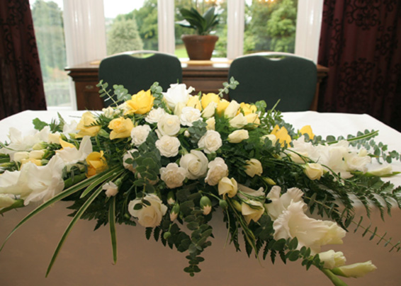Stephen & Lisa, lemon and white top table arrangment, gladioli and roses