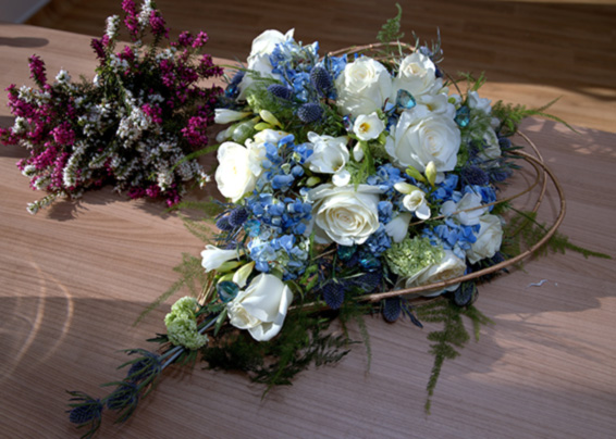 heart shaped wedding bouquet,blue and white with hydrangea, eryngium, roses and gems