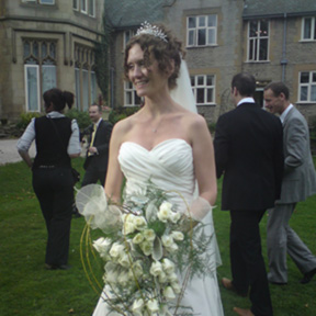 Bride with her contemporary shower bouquet, roses and skeletal leaves, Kenwood Hall, Sheffield